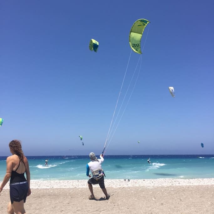 Organised beach with the best kitesurf school on the island, a few sunbeds and a cantine with homemade local food.