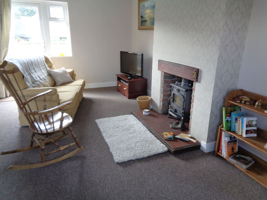 Light airy lounge with multi fuel burner and TV/DVD player with selection of DVDs,books,leaflets