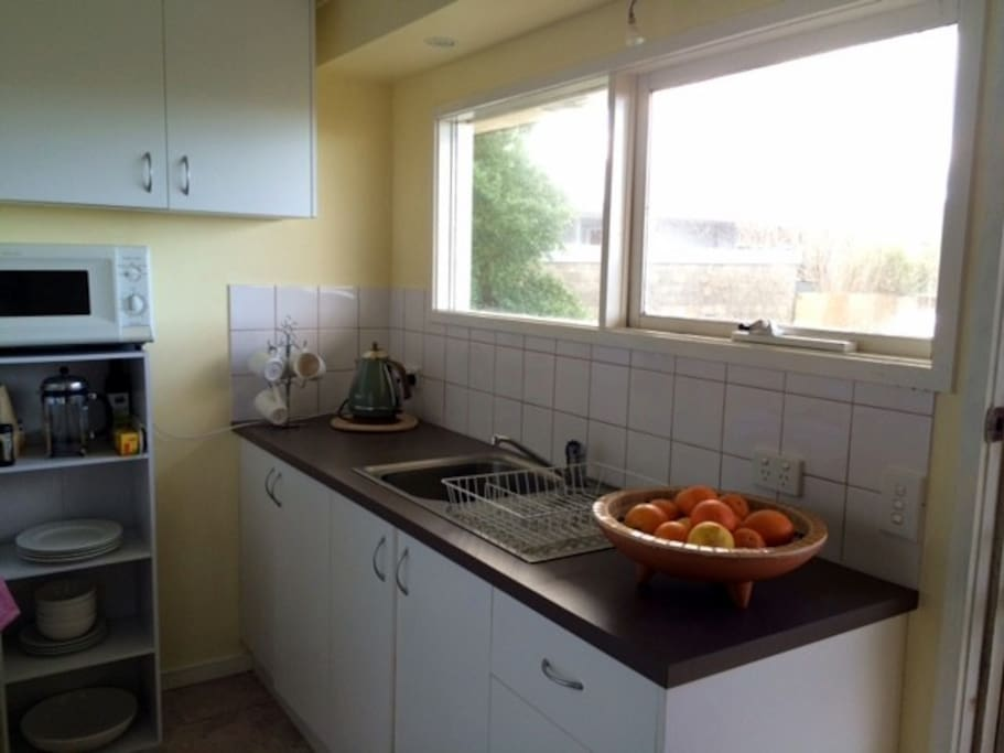 The kitchen is functional and well equipped for meal preparation.
