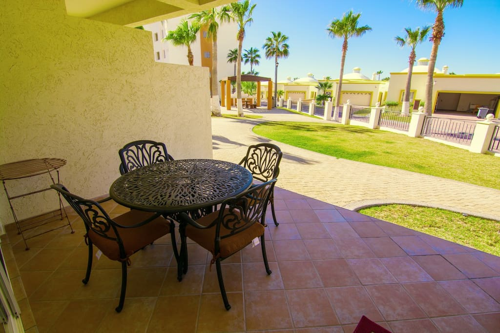 Chair,Furniture,Patio,Building,Palm Tree