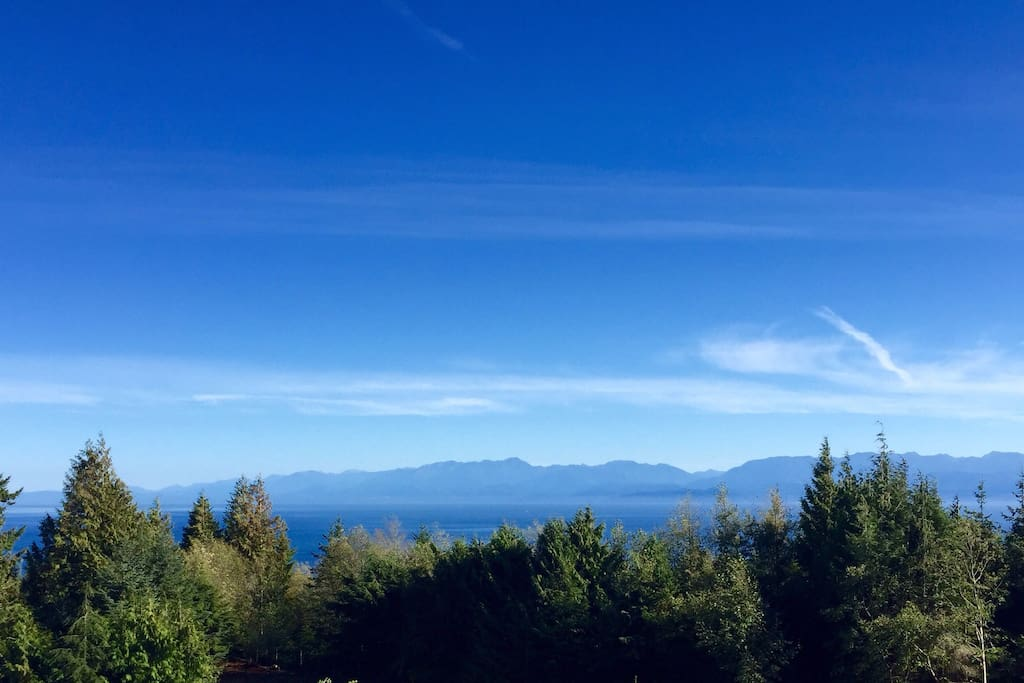 View of Ocean and Olympic Mountains from Rooftop Patio