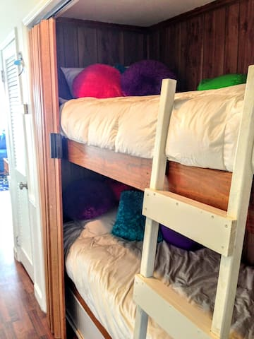 Bunk beds in the hall with an accordian door.  Kiddos LOVE them.  Even when my kiddos were teenagers they loved that they could block out the daylight until early afternoon.