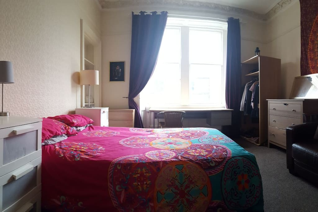 Bedroom 1 with Double bed, sofa and splendid views of the Castle