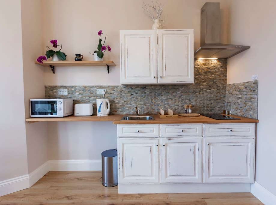 Kitchenette - equipped with a kettle, toaster, microwave, stovetop, sink, pots & pans and utensils, crockery and cutlery. We also provide complimentary tea/coffee and some cooking essentials.