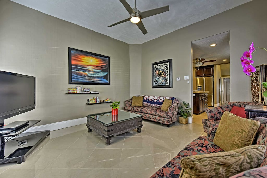 High ceilings highlight the spacious living room.