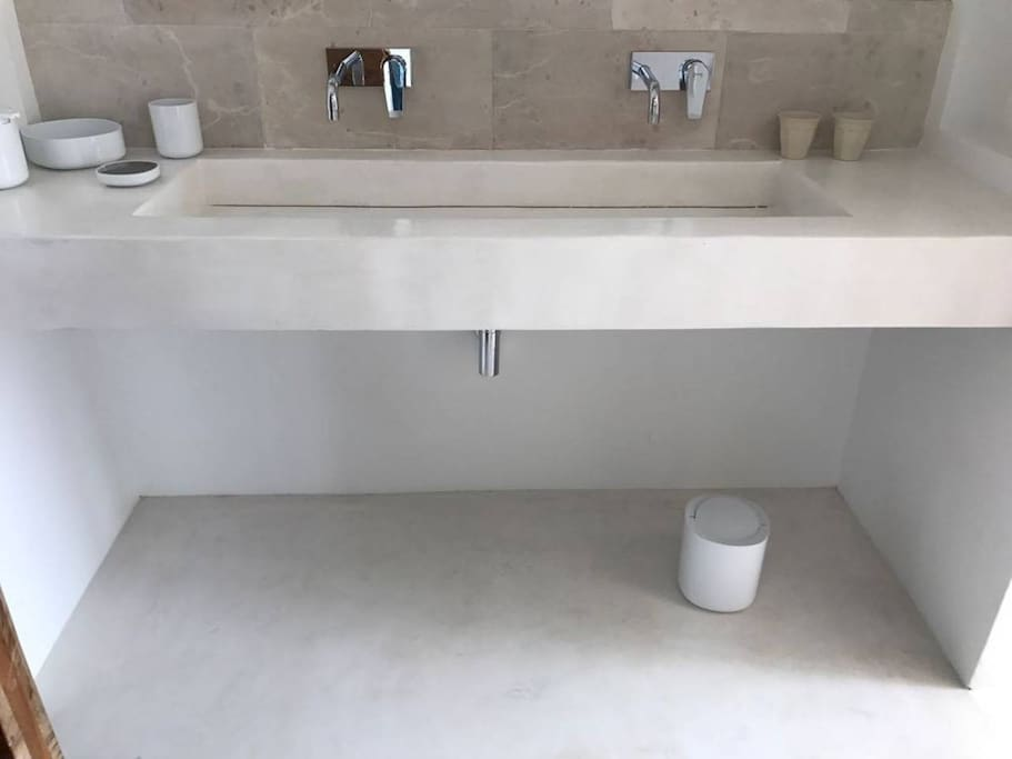 This is what the bathroom will look like - polished white concrete custom made sink.