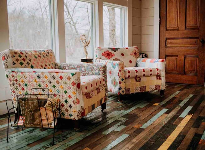 Curl up with a good book in my favorite chairs! Custom designed and made from antique quilts! Good view to enjoy your afternoon cup of tea. And yes, that just might be one of my husband's hard earned Emmy Awards you spot in that photo!