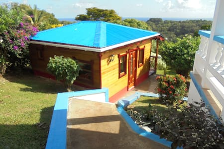 Idyllic Caribbean Lodge with views - Calibishie