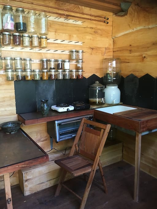 The kitchen comes stocked with fresh water and large spice rack, as well as other essentials