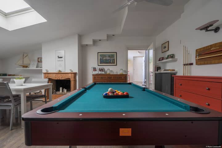 Mansarde apartment with pool table