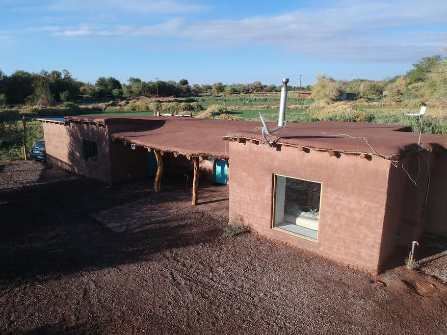 Aerial view of the house and the terrain / Vista aerea de la casa, quincho y el terreno.