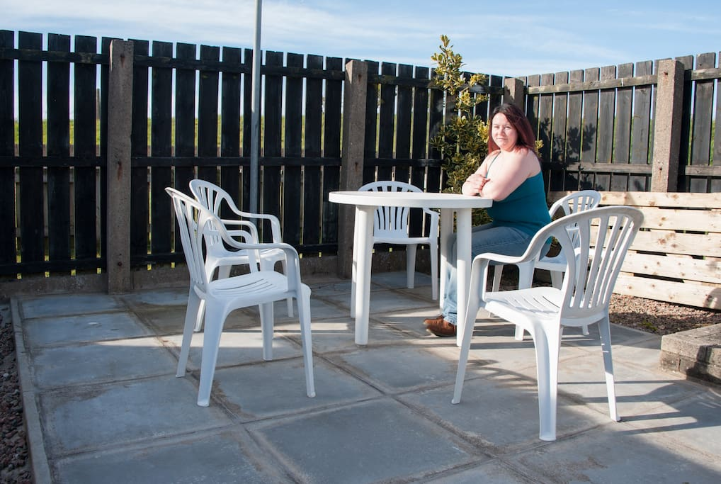 The rear patio and secluded seating area