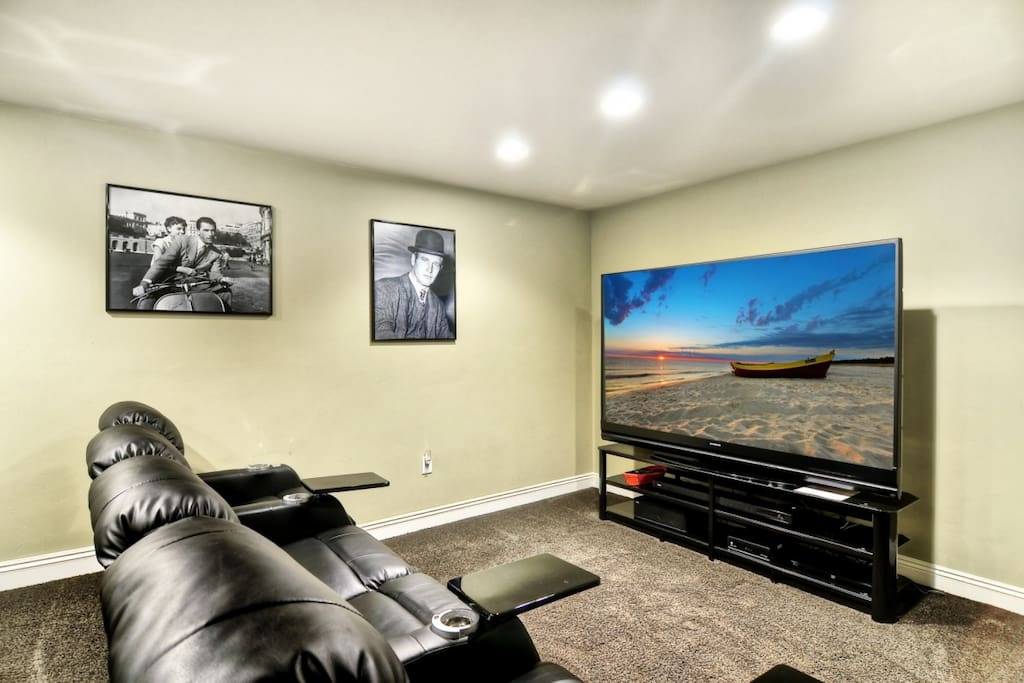 Theater room with 82 inch TV