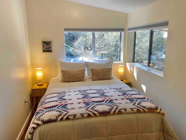 Bedroom 1  Bedroom 1 has a separate bedroom w/queen bed, and a living room suite with a sofa that converts with a topper to a comfy bed w/big screen tv.  Bathroom 1 is in this large suite that perfectly accommodates 4 guests.  Locking privacy door.