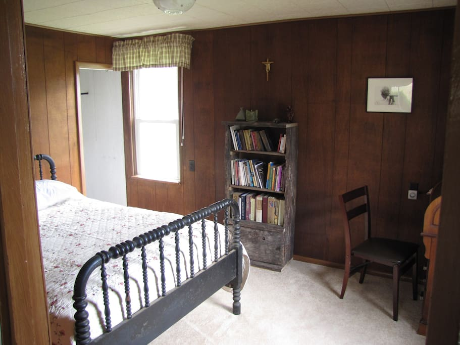 Master bedroom: double bed, roll top desk, bookcase and closet