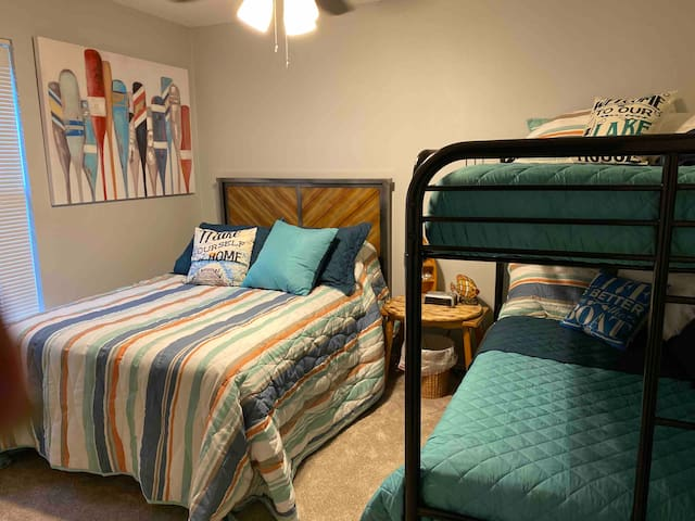 The second bedroom has a full bed and a bunk bed. Even though there are ceiling fans in each room, we have furnished a small fan in each bedroom for those of you who like white noise while you sleep.