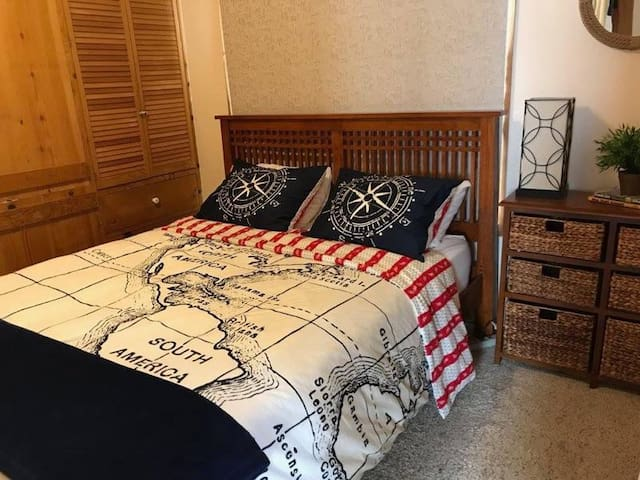 The master bedroom offers a queen bed.