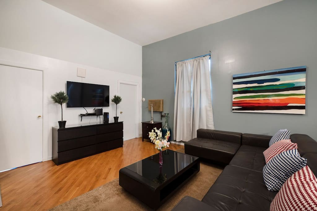Main seating area includes a large flat screen tv, Wrap around couch, perfect for seating, and comfortable living space for all guests to enjoy. High speed wifi and premium cable included