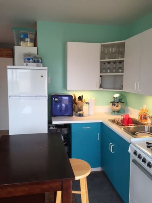 The kitchen is small but very functional with fridge, microwave and other appliances.