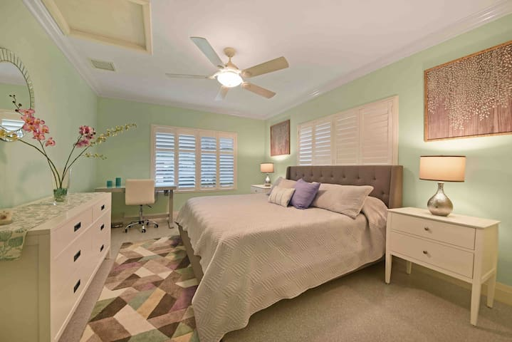 Split bedroom with a king size bed and your own office desk equipped with USB outlets