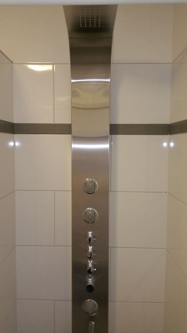 Luxurious design shower with waterfall and massage jets