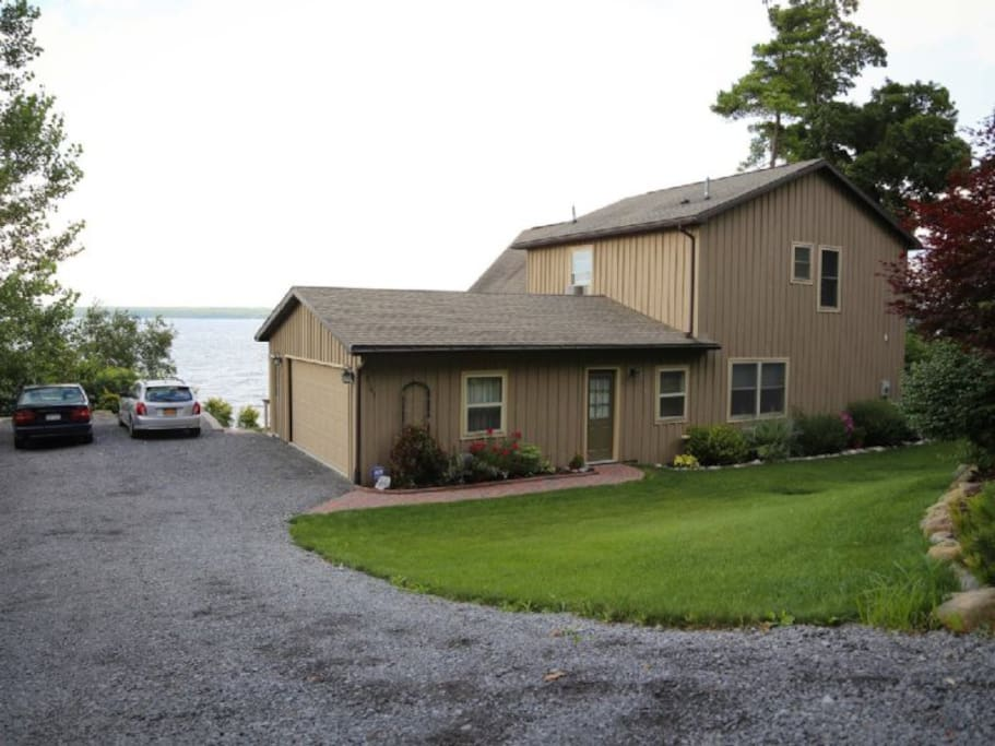 The rear of the house with the driveway and garage.