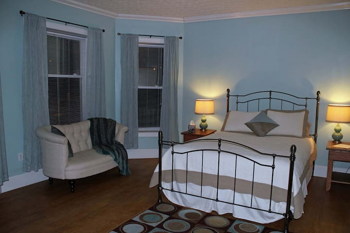 Room 2 -- Located on second floor. Features a private balcony and fireplace, very spacious.