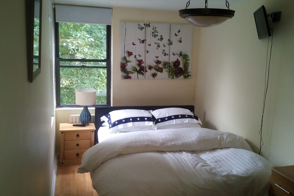 Large airy bedroom with kingsize bed.