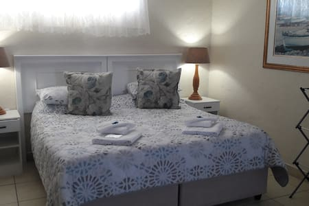 King Size Bed, Head Boards, Comverter, Blanket, Fitted and Flat Sheets,  with Side Tables, Bedside Lamps.