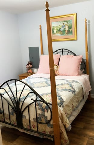 This bedroom has a full size bed.