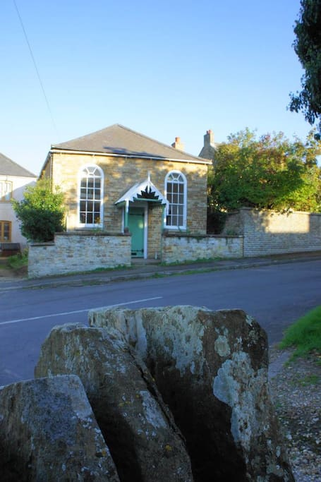 The charming exterior is a solid stone village chapel built in 1841