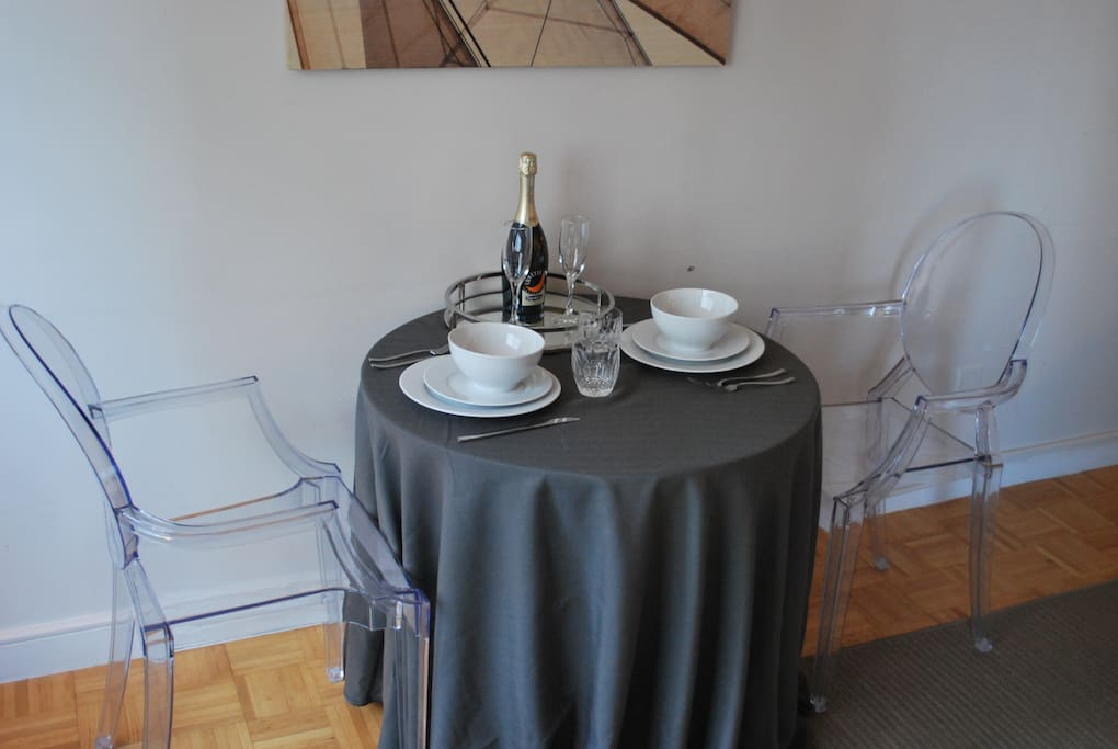 Dining area with full set of dishes, glassware, and flatware.