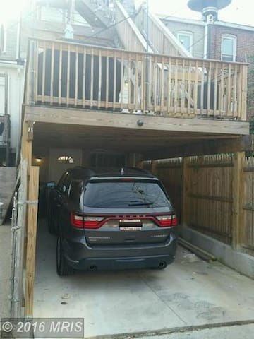Private car port that leads into the guest room. Public street parking is ample