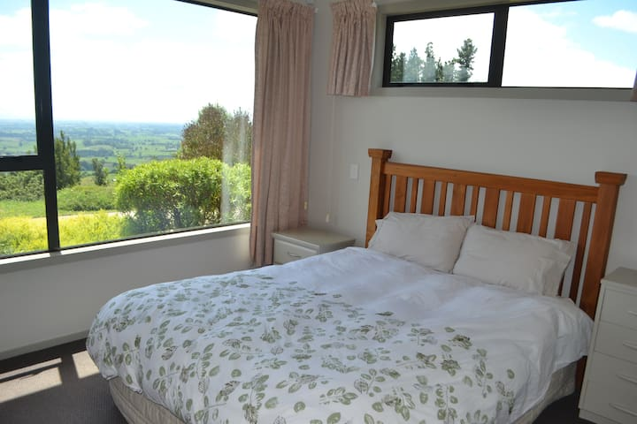 Master bedroom with built in wardrobe, electric alarm clock, air conditioning and plenty of storage.