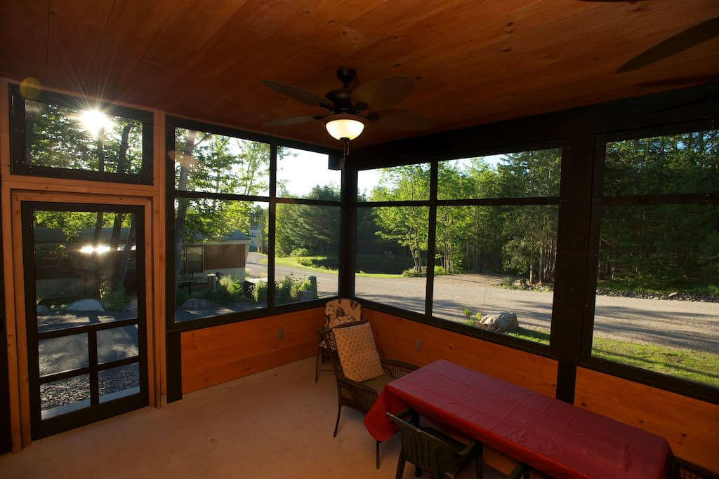 Screened in porch with plenty of space for dining
