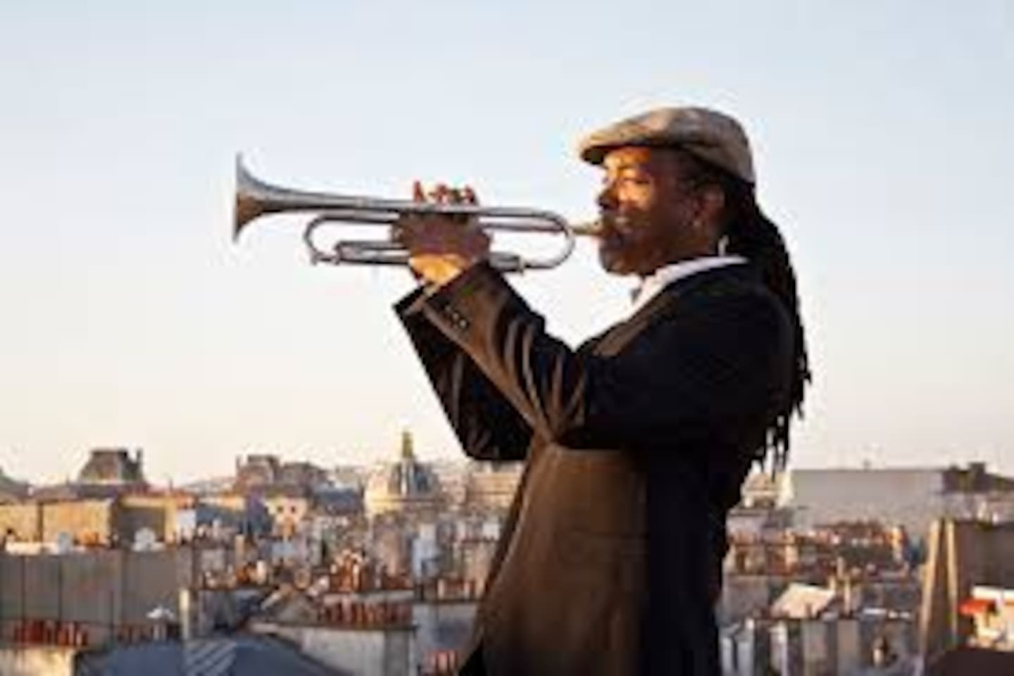 in memory of Miles Davis who played the trumpet on our roof and composed his jazz melodies