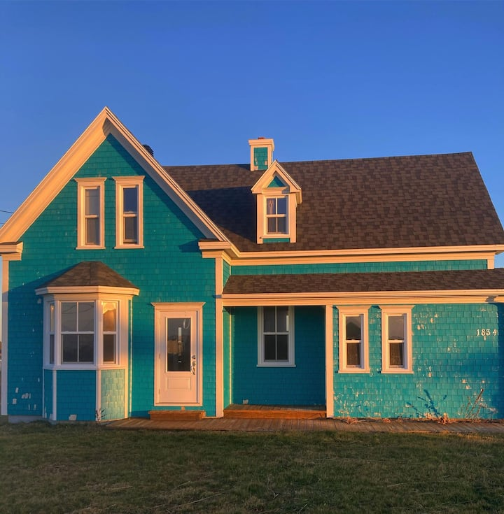 Maison turquoise à l'Étang-du-Nord