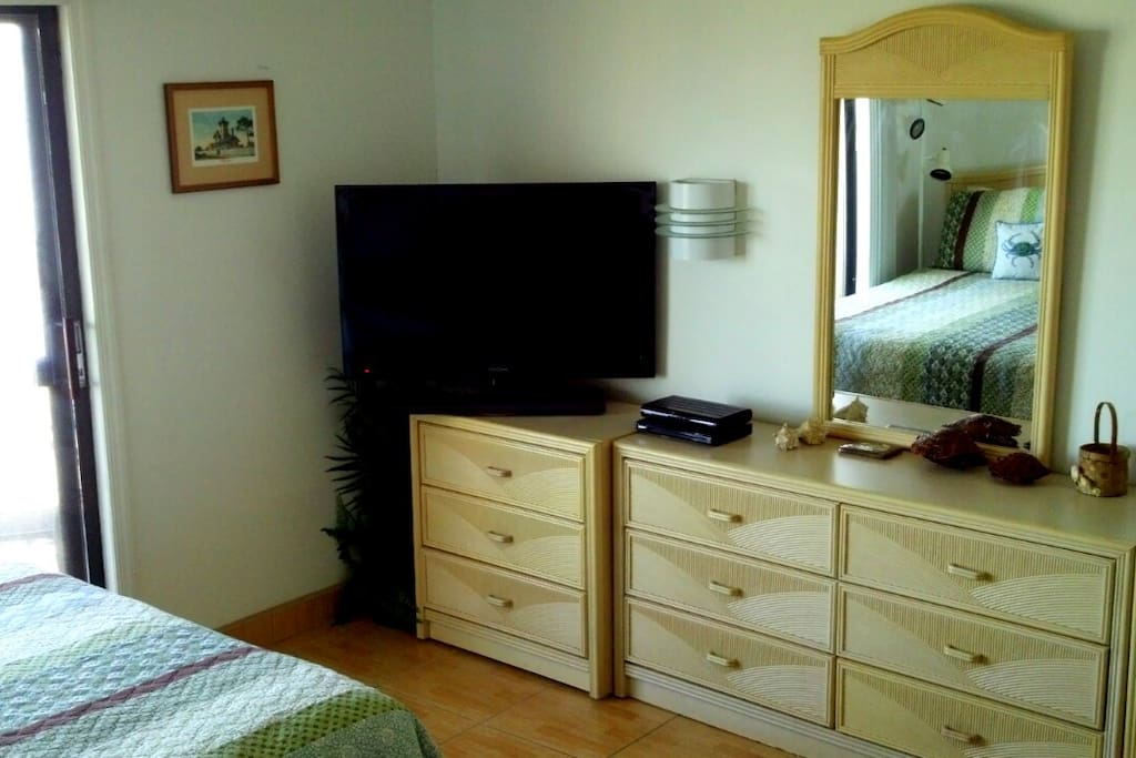 "Bedroom - 40"" swivel flat screen with DVD & cable television."