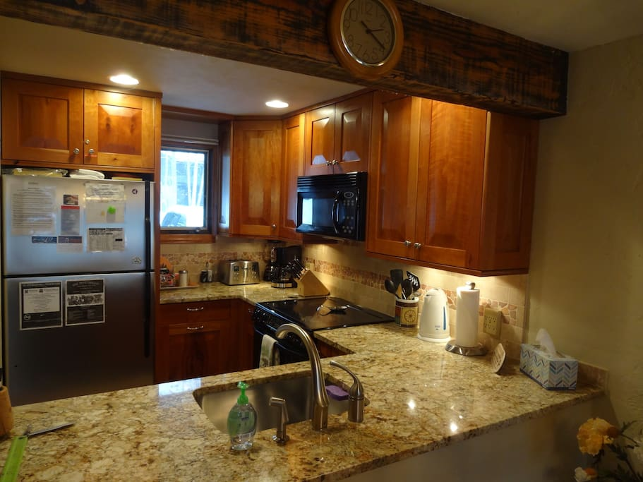 Fully-equipped kitchen with granite countertop