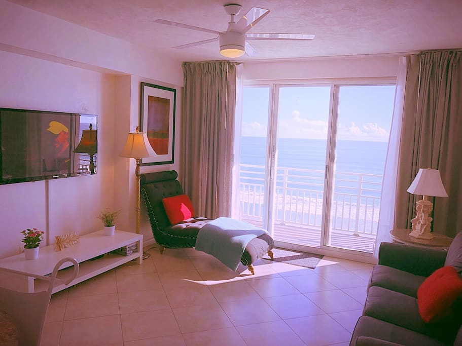 Relaxing on the lounge chair looking out to deep blue ocean at Oceanwalk 707.