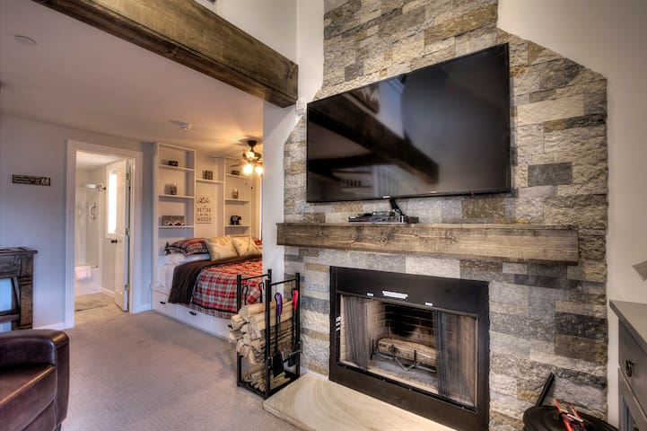 """55"""" Smart TV with Free Netflix  over custom Stone Fireplace (carpet replaced with new flooring 1/2019)"""