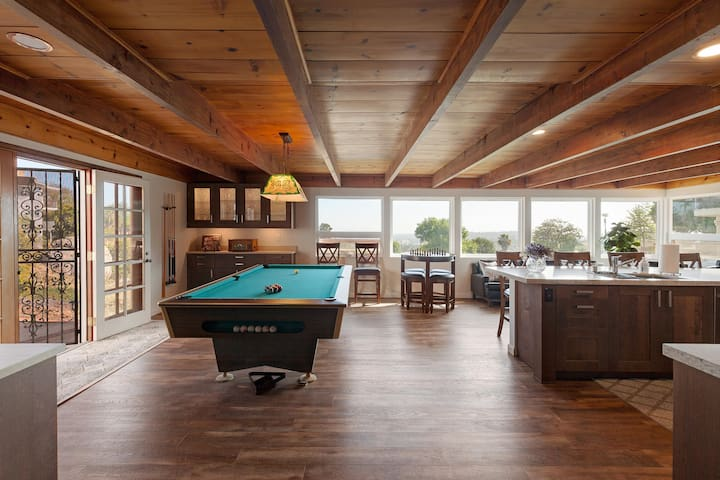 Downstairs game room and kitchen with panoramic views.