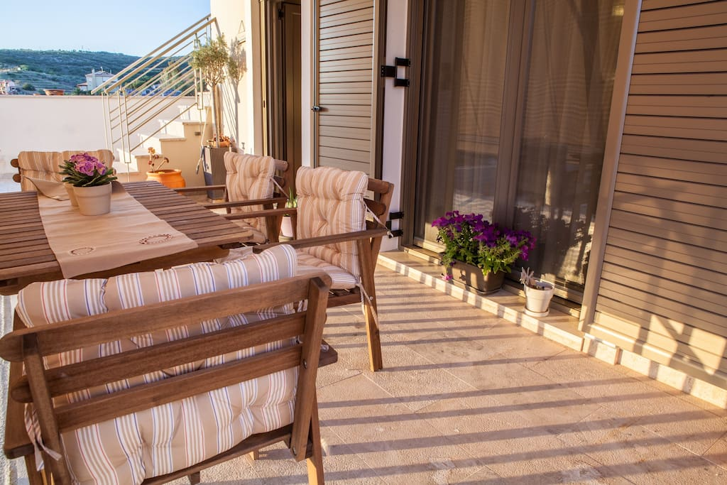 The verandah outside with furniture to enjoy the countryside