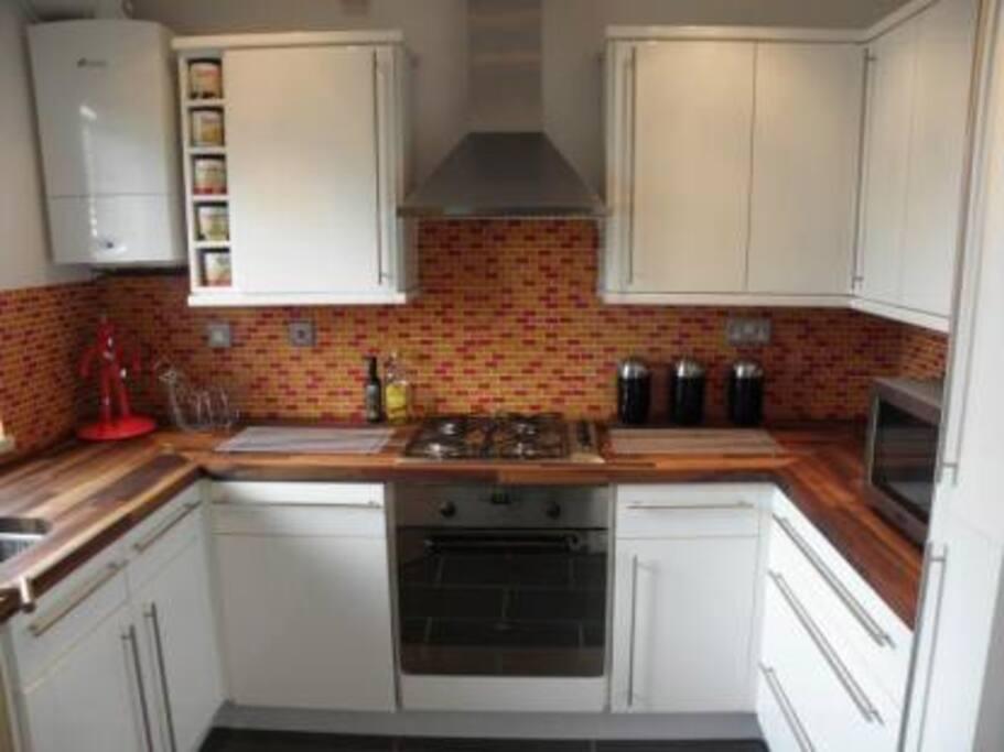amazing kitchen with gas cooker, large fridge/freezer, washing machine