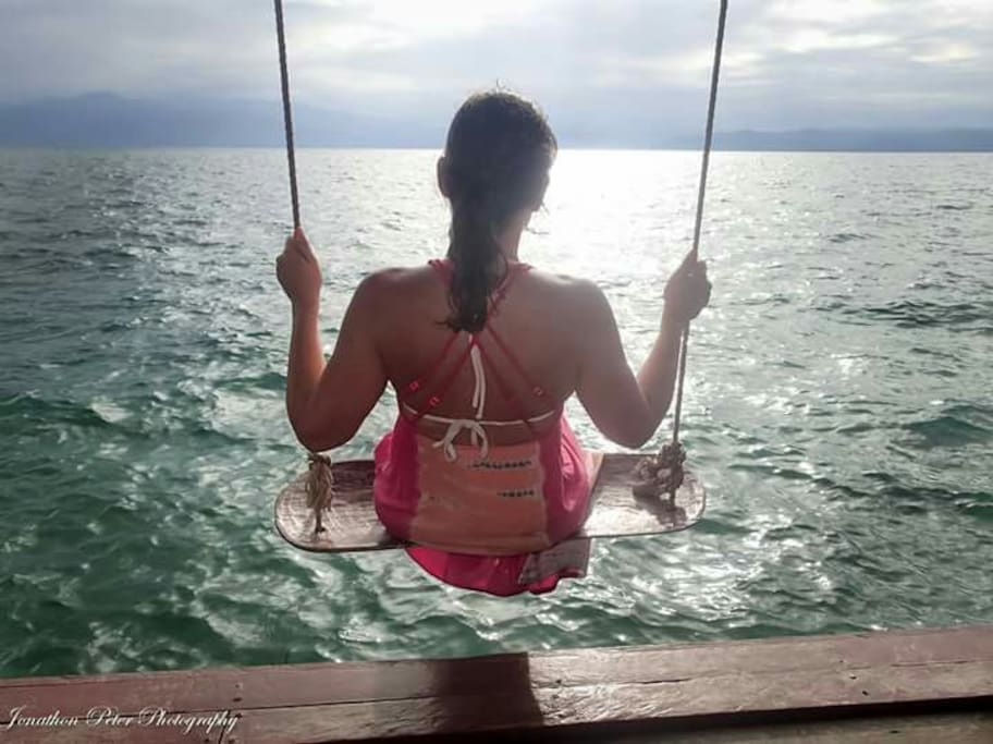 Swing over the turquoise water while looking at Volcan Baru!