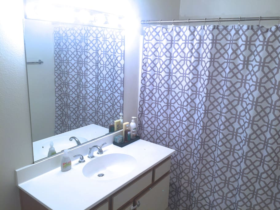 Private, full bathroom with tub.