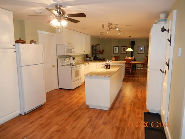Basement entrance of the fully outfitted spacious kitchen for all your cooking needs.  Hooks for coats & boot trays.