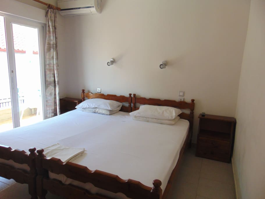 bedroom with one double and one single bed