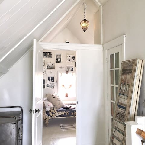 Entrance to the attic bedroom. The plexiglass above the door lets the morning light flood in.