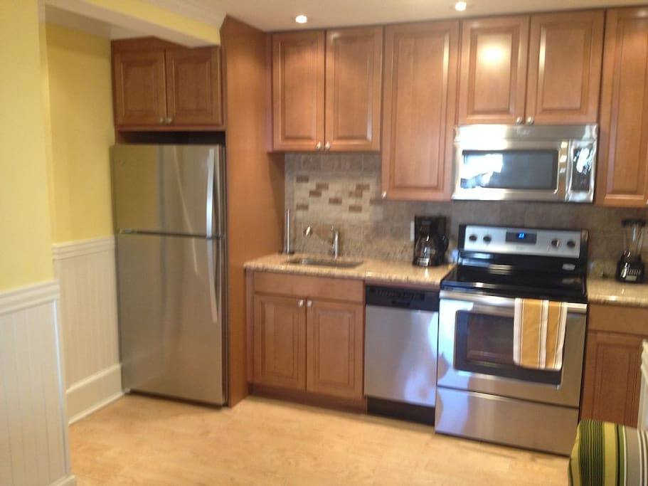 Granite Kitchen, Stainless Appliances.